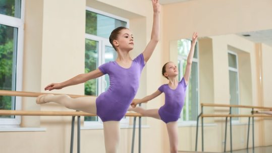 Teens during ballet lessons at ballet school