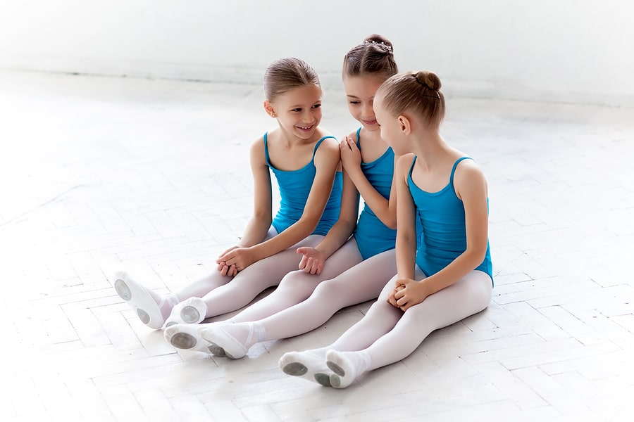 Three young ballerina during ballet lessons