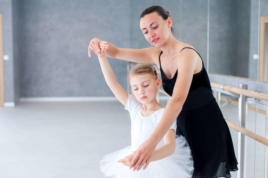 Ballet instructor teaching ballet classes for kids