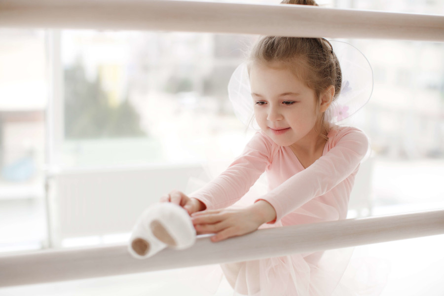 Young ballerina at ballet school