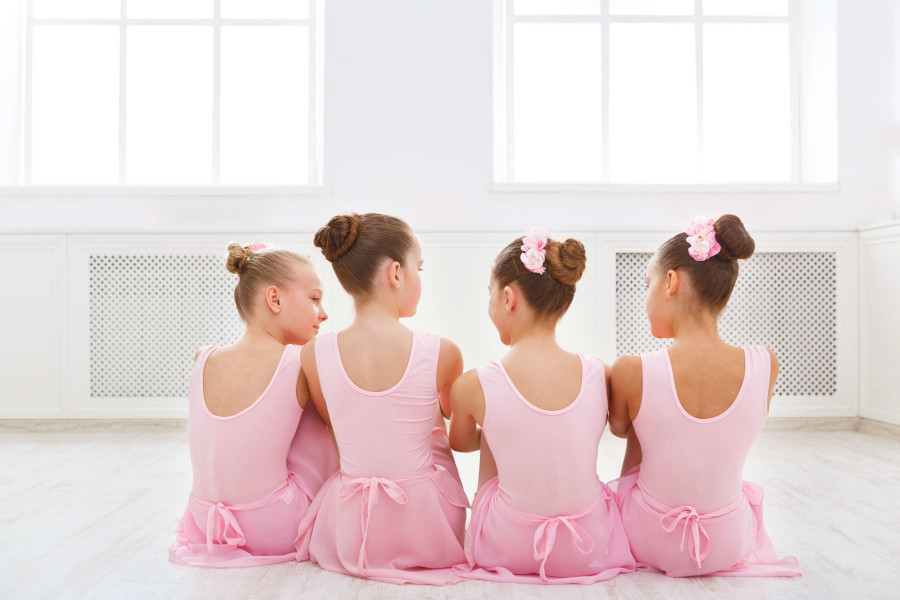 Young girls making friends at ballet school