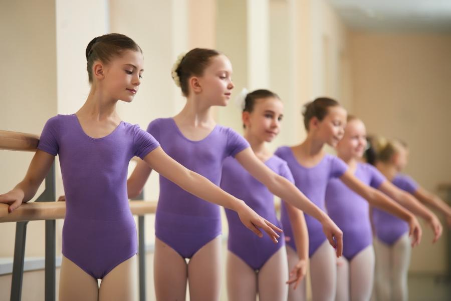 Ballet dancers warming up at barre