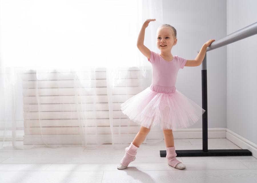 Young ballerina practicing at ballet academy